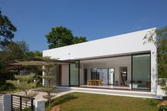 Upper Seletar reservoir, the Mandai Courtyard House is a peaceful single-story bungalow that's not often seen on the island of Singapore. Atelier M + A