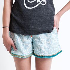 Love these AND this organization!  DIVYA mini. Low-rise, complementing drawstring at elasticized waistband, wood beads on drawstring, pleated ruffle at hem.    PUNJAMMIES™ by International Princess Project.  Pajamas handmade for women by women with hope from India. We advocate for women enslaved in prostitution; Restore their broken lives; and, Empower them to live free. Read our story here: http://punjammies.com/pages/the-story-of-punjammies