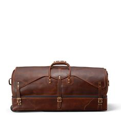 Distressed full-grain all leather rolling wheeled duffle bag. Hand buffed and antiqued. Complimentary embossed personalization. Made in USA. Guaranteed for Life.