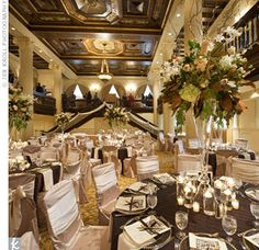 For the reception, guests were treated to a beautiful champagne brunch at the Amway grand Plaza hotel in Grand Rapids. Each table was covered by a chocolate brown pin-tuck linen and chairs were decorated with champagen lamour and ivory lamour ties. Photo by Jen Kroll Photography