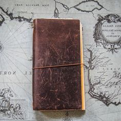 (owned )My own journal in the vein of Dr. Henry Jones's Grail diary Midori Traveler's Notebook--simply beautiful!
