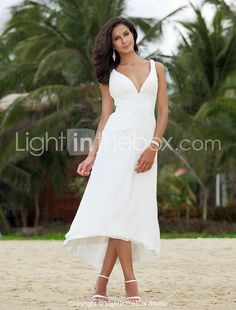 This I LOVE.  I don't know if the top will be too revealing or not, but what a pretty beach dress.  I like how it gathers in the middle and that it's angular.