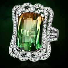 Bicolor tourmaline for a summer flash back! Central stone in 21 ct.... :-)