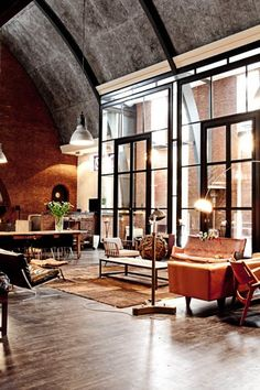 Glass, brick, and panels converge to provide this space with an eclectic backdrop that frames the decor perfectly. #interiordesign #architecture