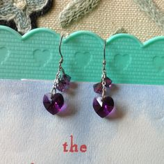 Handmade Crystal Purple Heart Earrings Valentine 📍🔖 This Item must be purchased in a bundle. Not for Individual sale 📣 〰〰〰 Great condition. Short and dangly. Dress fancy or casual and add some sparkle. Clarke your crown chakra. Spiritual royal purple. Valentine's. Day romantic gift. Swarovski Jewelry Earrings