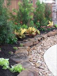 might need to copy the small rocks idea to keep mulch from rinsing off onto brick pathway Front Yard Landscaping, Inexpensive Landscaping, River Rock Landscaping, Landscaping Design, Tropical Landscaping, Landscaping Jobs, Corner Landscaping Ideas, Landscaping With Rocks, Hillside Landscaping