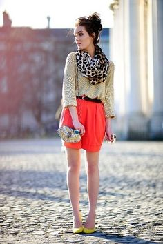 Trend mix: Casual bun, leopard scarf, neutral blouse, neon coral high waisted shorts and yellow heels