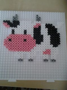 """Cow (Harvest Moon) hama beads by Ceri Humphreys"" strange how I can instantly recognize a cow. Harvest Mood is very addicting. Hama Beads Design, Diy Perler Beads, Perler Bead Art, Pearler Beads, Fuse Beads, Pearler Bead Patterns, Perler Patterns, Hama Beads Animals, Beads Pictures"