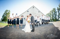 #Country #Wedding - bridal party jump shot in front of the #white barn at #Langdon Farms