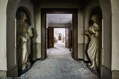 Place of worship: Two religious statues - in almost perfect condition - still stand in this abandoned Belgian monastery