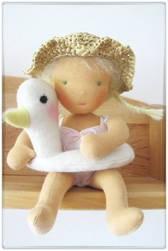Millie - a 10 inch doll inspired by Waldorf tradition - with swimsuit, summer hat and her swim ring duck