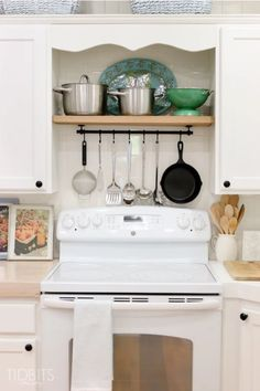 When you're organizing your kitchen, don't be afraid to look up above your range. When you store your pots and cooking utensils above your stovetop, everything you need is always at-hand. Click through for more on this and other kitchen organization ideas.