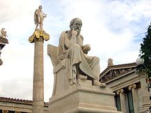 Statue of Socrates with the Apollo column in the background (work of Leonidas Drosis).