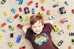 I don't love styled props, but I love   props that mean something and define who a child is and what he/she enjoy at the   moment. So, this kids must love Hot Wheels. Cute idea for photographing a child   with their favorite thing of the moment