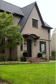 tudor revival home with warm taupe exterior, pantone warm taupe, brownish-taupe