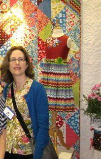Don't you LOVE whe a designer really commits to her palette?? ) Here's Marcus design director Laura Berringer, in front of a quilt usign her SPINTASTIC line!  http://www.marcusfabrics.com/cgi-bin/fabricgallery/gallery.cgi?Category=647