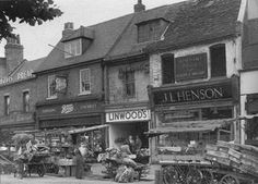 East side of The Green 1949. Boots are still around. The market stalls lasted until 1970.