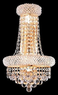 Bagel Design 4-Light 17'' Gold or Chrome Wall Sconce Dressed with European or Swarovski Crystals. If you are looking for a plain wall sconce to place in a corner this may not be the piece for you. This piece made it's way to our best seller's of 2014 by people who wanted to bring a touch of elegant glamour into their home. With a price of only $156.70 this piece is a steal.