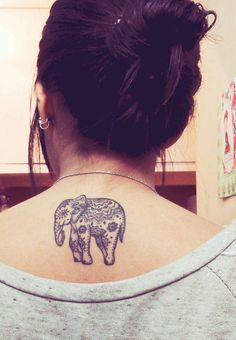 Ornamental style elephant tattoo on the upper back.