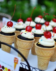Ice cream cone cupcakes! I would do this with ice cream on the top instead of frosting for child's birthday party. What fun!
