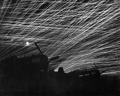 Anti-aircraft tracers in the night sky above Yontan Airfield, Okinawa, Japan, 28 April 1945. http://wrhstol.com/2lj0WzQ