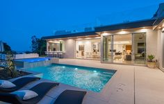 A beautiful outdoor deck that features both a pool and spa and expansive lounging area that the entire house looks out over. 318 Bellino Drive | Pacific Palisades