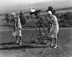 """Women practice their swing with golf lessons from a """"robot"""" trainer (1925)."""