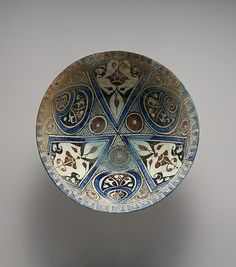 munan15:  Bowl Date: late 12th–early 13th century Geography: Syria, probably Damascus Medium: Stonepaste; polychrome-painted under transpare...