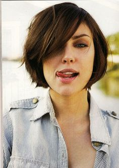 Bob Hair with Long Side-swept Bangs and Cool Layers at the Sides and Back
