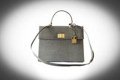 Patent gray handbag