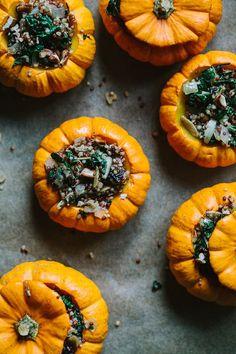 Quinoa stuffed mini pumpkins with kale, cranberries, and pecans.