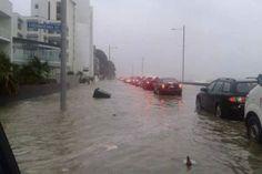 Surface flooding on Auckland's Tamaki Drive. Photo / Sam Hargreaves