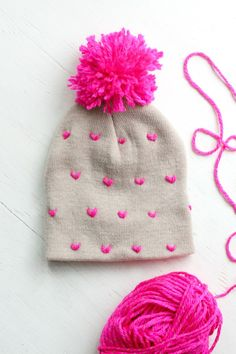 DIY Heart-Patterned Pom Pom Beanie | The Pretty Life Girls Handmade Valentine Gifts, Valentines Diy, How To Darn Socks, Balloons And More, Tie Dye, Cute Beanies, Pom Pom Crafts, Heart Patterns, Knot Headband