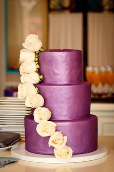 Purple wedding cake | White Roses | Wasio Photography www.weddingwire.com