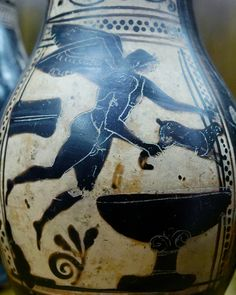 Flying Eros holding a hare. Black-figure olpe. Greek, early 5th century BC.  Capitoline Museums, Rome