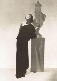 A Vionnet one-shoulder black velvet dress, inspired by ancient-Egyptian styles. Photograph by Hoyningen-Huene, 1936.