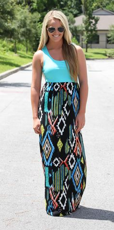 """This aztec maxi features a great pop of aqua in top and aztec multi print bottom. Model is 5'5"""" wearing a small. 100% poly, unlined but not sheer."""