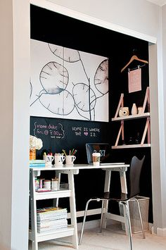 love the idea of a chalk board wall behind the closet office.