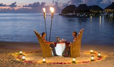"""Moorea is also known as the """"Island of Love"""" because of its heart shape. That's why Hilton Moorea Lagoon Resort & Spa offers a unique beach dinner under the stars, illuminated by Tiki torches facing the lagoon. Moorea Island, Tahiti Vacations, Moorea Tahiti, Bungalow, Travel Captions, Beach Dinner, Travel Specials, Vacation Deals, Beautiful Hotels"""