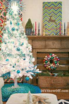 turquoise white Christmas tree. This actually looks like my mothers trees. She had the artificial white and would change colors out every year. The difference? the top and skirt and the ribbons hanging down. These things were thought of in the 70's! :) but the colors and the flowers and stuff... you betcha she did that!