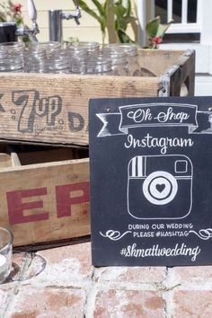 "Share your wedding hashtag with this ""oh snap!"" sign."