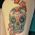 Skull with flower tattoos
