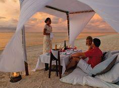 Romance on the beach at Pacific Resort Aitutaki, Cook Islands.