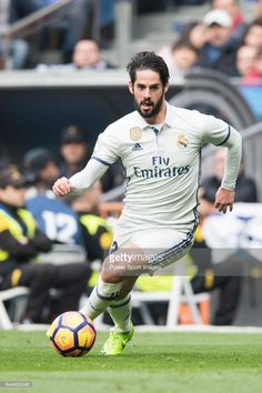 Isco Alarcon of Real Madrid runs with the ball during the match Real Madrid vs RCD Espanyol, a La Liga match at the Santiago Bernabeu Stadium on 18 February 2017 in Madrid, Spain.