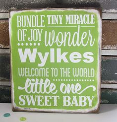 Personalized  Baby Subway Art Sign made from a painted wood board with vinyl lettering cut with a Silhouette Cameo.