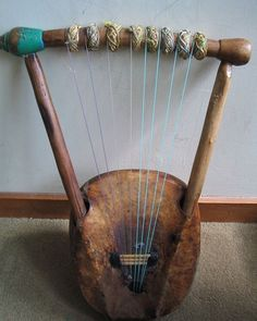 African Instruments // The Nyatiti, Kenya.  This is a 5 to 8 stringed lyre played by the Luo people of Western Kenya typically in Benga music.
