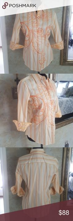 "NWT Robert Graham Embroidered Button Down NWOT Robert Graham Womens multi striped orange, yellow and gold button down. 6 mother of pearls buttons, embroidered design on inside of cuff with 2 buttons also. Size Small Petite but will fit XS to a Medium. Purchased and never worn! Blouse is  gorgeous with white capris, denim, or shorts! 27"" length 16"" shoulder to shoulder  19"" sleeve length  3"" cuffs Robert Graham Tops"