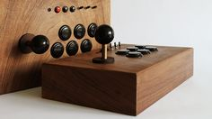 """Classic Arcade Games Deserve a Beautiful Wooden Console System: Swedish designer Love Hultén is freaking obsessed with classic arcade games. You'd have to be, to craft a beautiful wooden console with matching controllers just to house a massive collection of them. Awesome. At first, Hultén's R Kaid-42 (""""arcade for two"""", get it?) looks like an old, hand-crafted box. It's made of dark walnut with brass fittings, and measures about 7 x 7 x 14 inches, which is considerably smaller than even the…"""