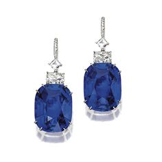 PAIR OF SAPPHIRE AND DIAMOND EARRINGS Set with 2 cushion-shaped sapphires weighing 16.28 and 17.94 carats, surmounted by 2 cushion-shaped and 2 square-cut diamonds, weighing a total of approximately 2.10 carats, mounted in platinum.