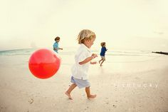 Beach, kid, red balloon; can't go wrong!